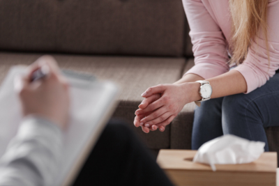 Close-up of woman`s hands during counseling meeting